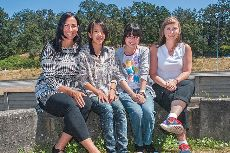 Fifteen-year-old Japanese exchange students Yui Matsumiya and Reina Yanagisawa are flanked by their homestay mom Alicia Brown, left, and Sarah Carrie, program co-ordinator for the Victoria division of Muskoka Language International.   - Kyle Slavin/News staff